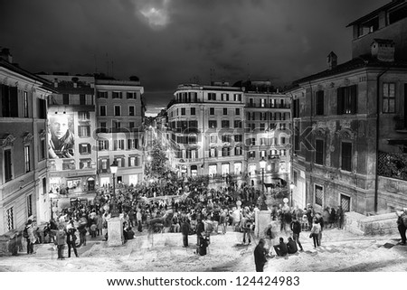 ROME - NOV 3: People climb the spanish steps of Piazza di Spagna on the evening of November 3, 2012 in Rome. The 'scalinata' is the widest staircase in Europe