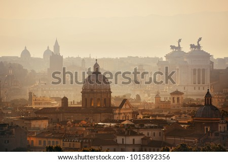 Rome rooftop view at sunrise silhouette with ancient architecture in Italy.