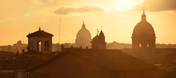 Rome rooftop view at sunset panorama with ancient architecture in Italy.