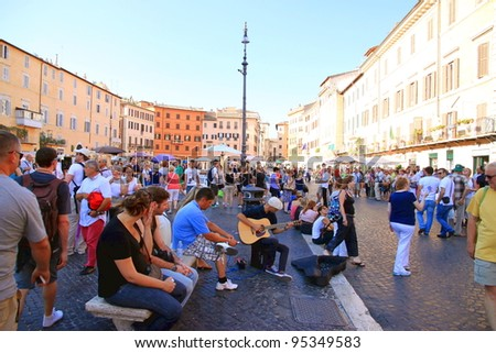 ROME - SEPTEMBER 17: Piazza Navona on September 17, 2011 in Rome. Piazza Navona is one of the main sights in Rome, which is the 3rd most visited city in Europe. - stock photo