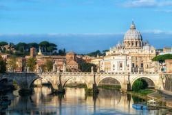 Rome Skyline with Vatican St Peter Basilica of Vatican and St Angelo Bridge crossing Tiber River in the city center of Rome Italy. It is historic landmark of the Ancient Rome and travel destination.