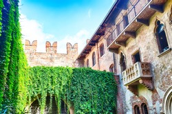 Romeo and Juliet balcony in Verona, Italy during summer day and blue sky.