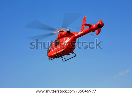 ROMFORD, ESSEX - AUG 9: A Virgin air ambulance takes off after attending to a patient and taken to hospital August 9, 2009, in Romford, Essex, England. - stock photo