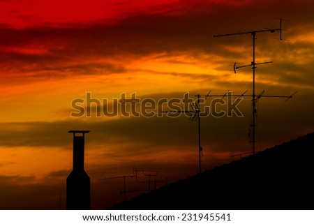 Roof Antennas Silhouette at Sunset