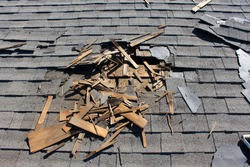 Roof construction site. Removal of old roof, replacement with new shingles, equipment and repair. Roofs are a very important part of all housing projects around the world.