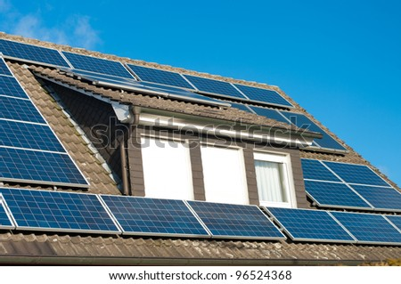 roof of a house covered with solar panels