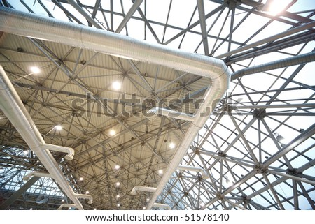 Roof of building from inside: extinguishing system and lighting. Frame of steel structures.