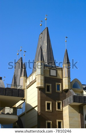 Roof of european-style building in a sun day. Vertical shot. Kemer, Turkey. - stock photo