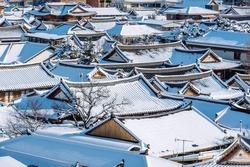 Roof of Jeonju traditional Korean village covered with snow, Jeonju Hanok village in winter, South Korea.