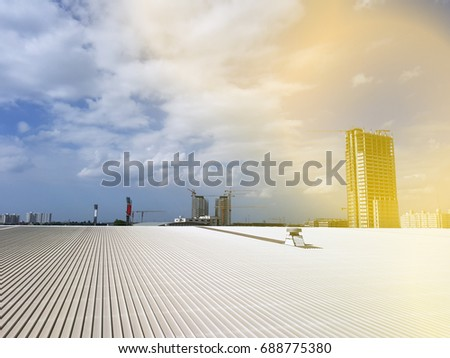 roof of metal sheet building with clear blue sky background #688775380