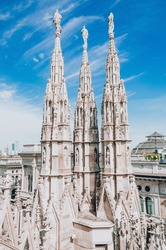Roof of Milan Cathedral Duomo di Milano with Gothic spires.