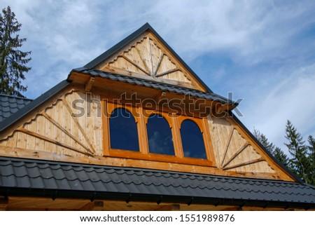 roof of modern modern wooden cottage  #1551989876