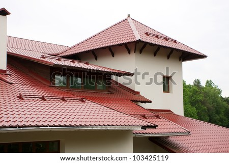 Roof Of The House Lined With Red Roof Tiles Stock Photo