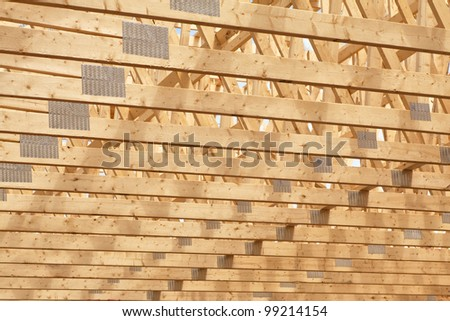 Roof rafters in the new construction of a wooden building or house. - stock photo