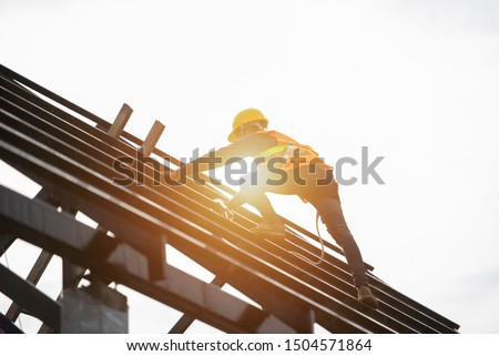 Roof repairman, construction engineer wearing safety inspection kit in Asia #1504571864