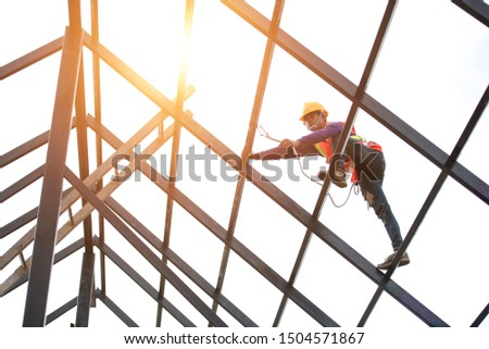 Roof repairman, construction engineer wearing safety inspection kit in Asia #1504571867