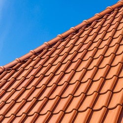 roof tile pattern, close up. Over blue sky