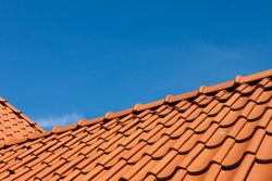 roof tile pattern over blue sky