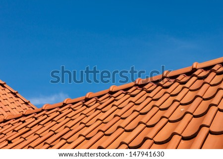 roof tile pattern over blue sky #147941630