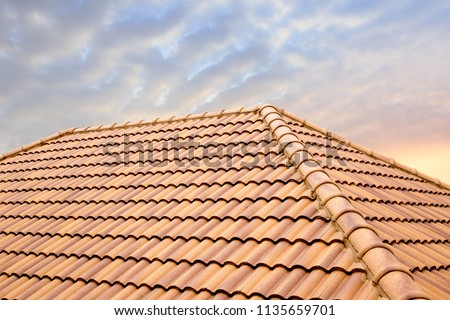 Roof tiles and sky sunlight.Roofing Contractors concept Installing House roof.  #1135659701