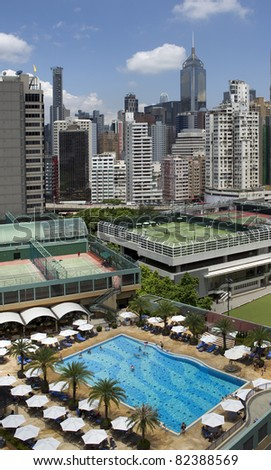 Roof top sport complex with swimming pool and tennis courts in downtown Hong Kong
