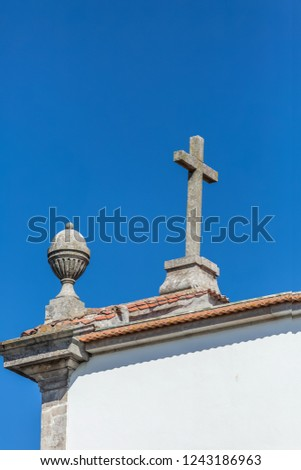 Roof view of Christian religious church, with cross and pinnacle, in Porto, Portugal...