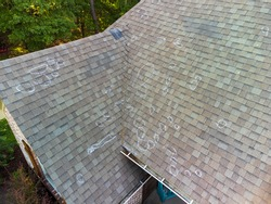 Roof with hail damage and chalk markings from inspection