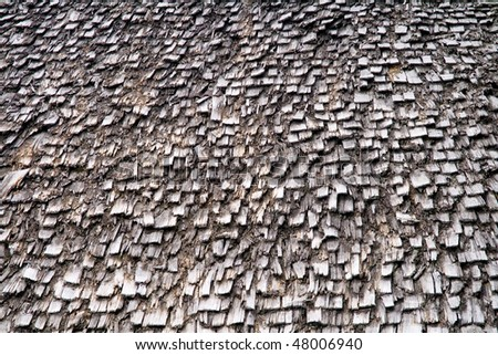 Roof with old and weathered wooden shingles