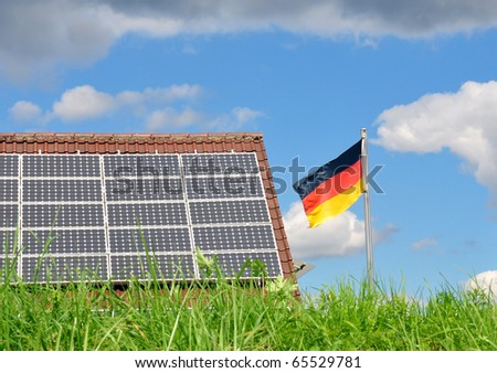 Roof with solar panels and German flag