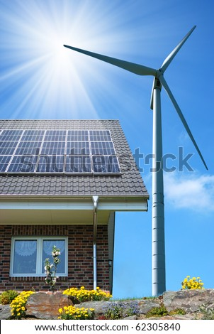 Roof with solar panels and wind turbines aside