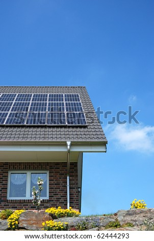 Roof with solar panels under blue sky