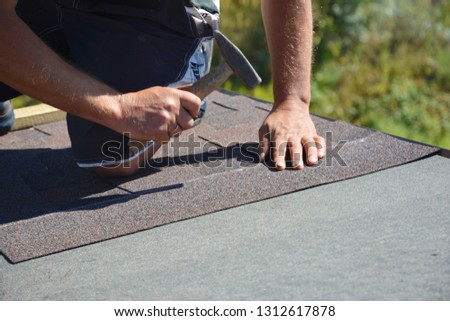 Construction worker cutting roll… Stock Photo 295096919