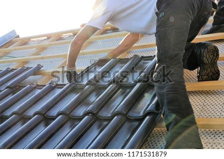 Roofing contractors working on a new roof