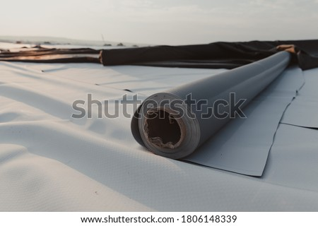 Photo of  Roofing PVC membrane in rolls placed on the roof of the site