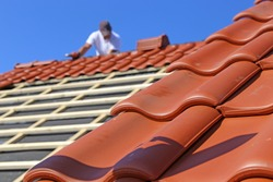 Roofing work, new covering of a tiled roof