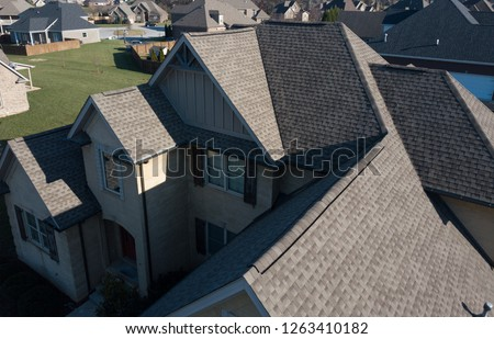 Roofline of ventless shingle roof showing gables