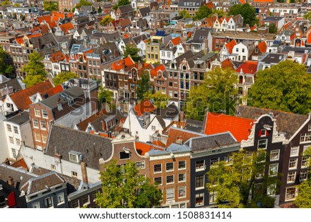 Roofs and facades of Amsterdam. City view from the bell tower of the church Westerkerk, Holland, Netherlands.