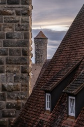 Roofs and historical buildings seen from the Medieval walls trail in Rothenburg ob der Tauber (Germany)
