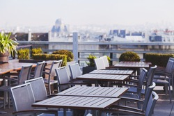 rooftop cafe, open terrace with wooden tables