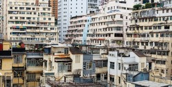 Rooftop slums (houses) and old buildings of Causeway Bay, Hong Kong where residential apartments are highly packed