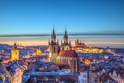 Rooftop view over historical center of Prague, Czech republic, EU. Tyn Church and Prague Castle in beautiful sunset light.