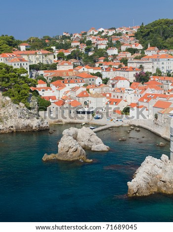 rooftops  and little marina of old town Dubrovnik with many old red roofed windows, Croatia