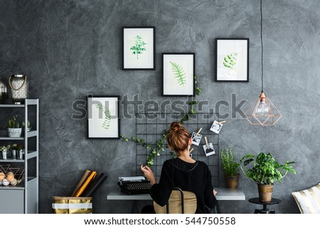 Room area with woman working at the desk