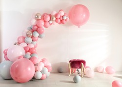 Room decorated with colorful balloons for party