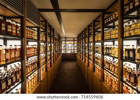 Room full of whisky cabinets storing different types of whiskey #714559606