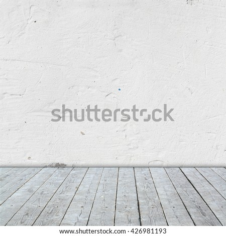 Shutterstock Room interior with gray wooden flor and white  plaster wall