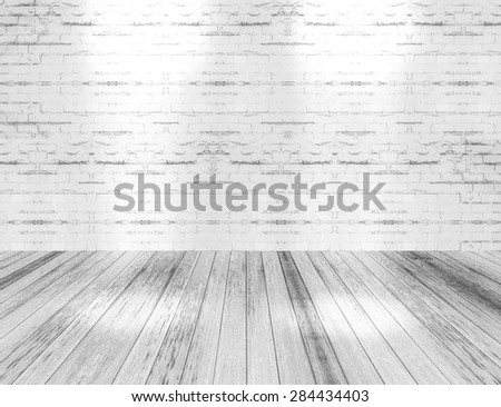 room interior with light shining down on the floor,white brick wall and wood floor background.