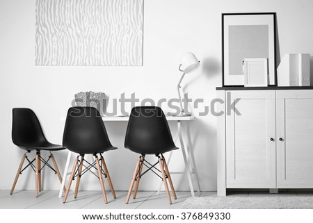 Room interior with picture, chairs and table on white wall background
