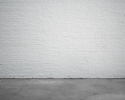 room interior with white brick wall and concrete floor, nobody, empty