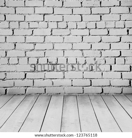 Room interior with white brick wall and wood floor